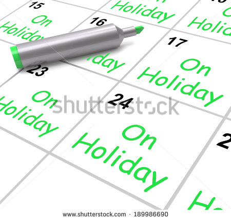 On Holiday Calendar Showing Annual Leave Or Time Off   Stock Photo