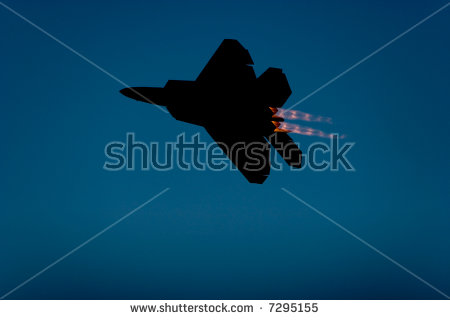 22 Raptor Jet Airplane Silhouette During Airshow   Stock Photo