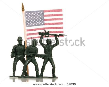Green Army Men Holding A Us Flag On White With Reflection    Stock