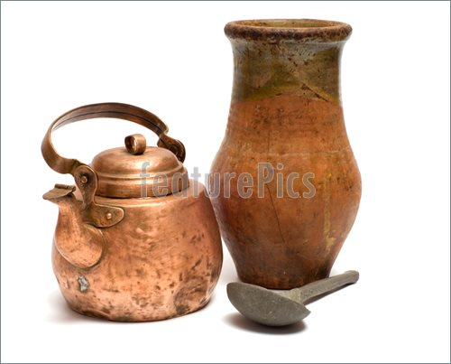 Pics Of The Old Copper Kettle Pewter Spoon And Ceramic Pot On A White