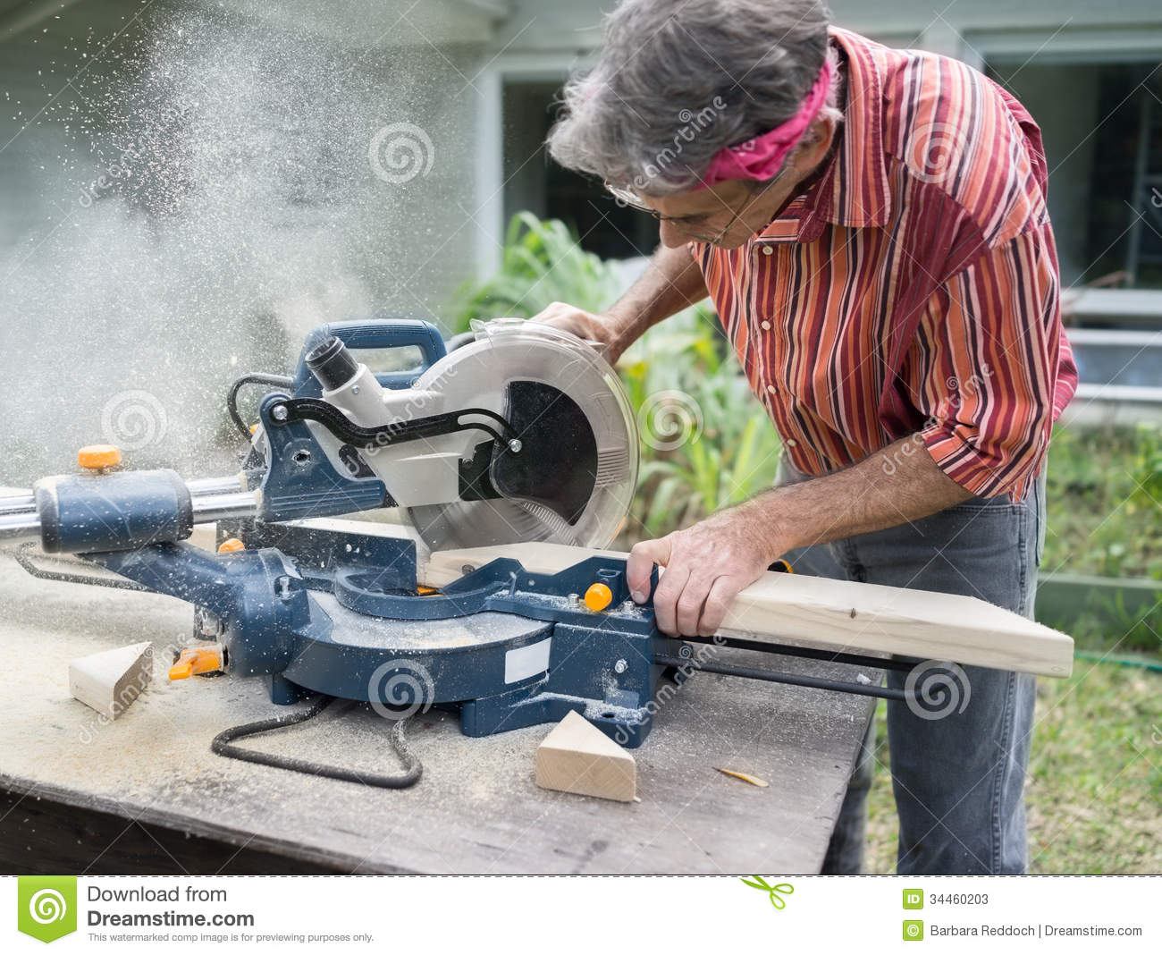 With Sliding Compound Miter Saw Outdoors Sawdust Flying Around