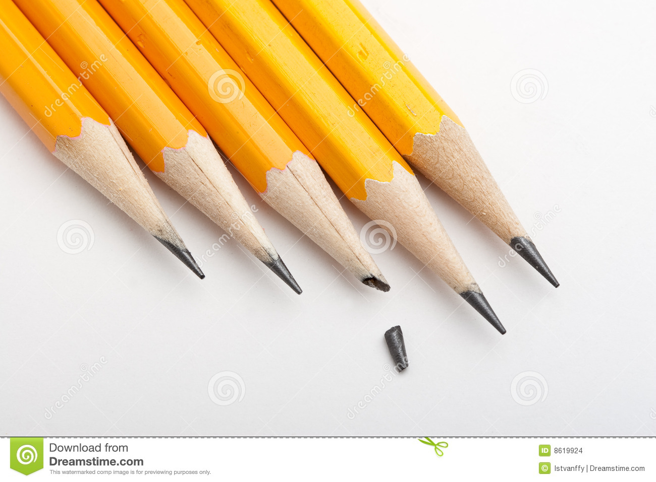 Line Of Sharpened Black Pencils With One Pencil With A Broken Point