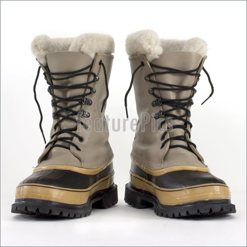Pair Of Heavy Snow Boots On White Background Low Angle Perspective