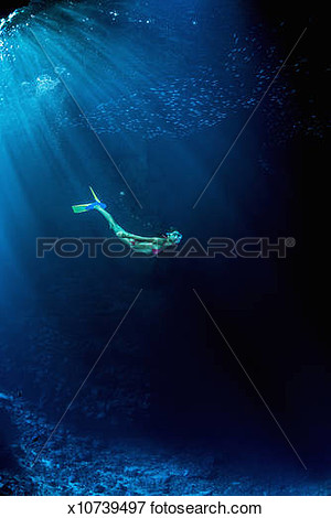 Picture   Female Snorkeler Exploring An Underwater Cave  Fotosearch