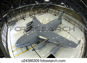Stock Photograph Of A C 17 Globemaster Iii Sits In The Hangar After