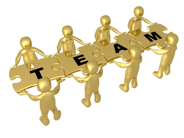 Clip Art Team Clip Art project team clipart kid of 8 gold people holding up connected pieces to a colorful puzzle