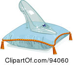 Glass Slipper On A Pillow Over Blue Pair Of Glass Princess Slippers