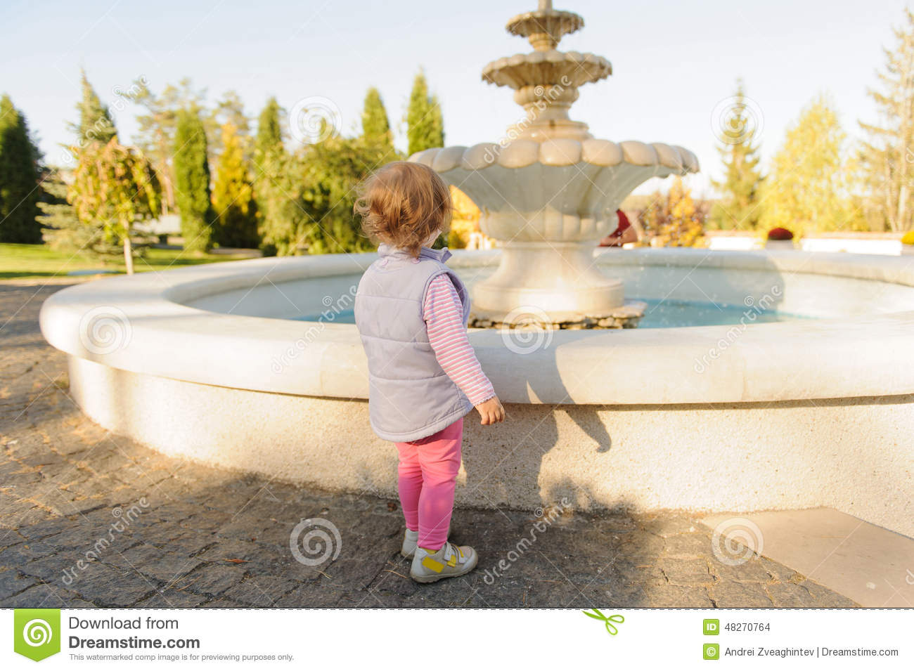Girl At Fountain In Yard Stock Photo   Image  48270764