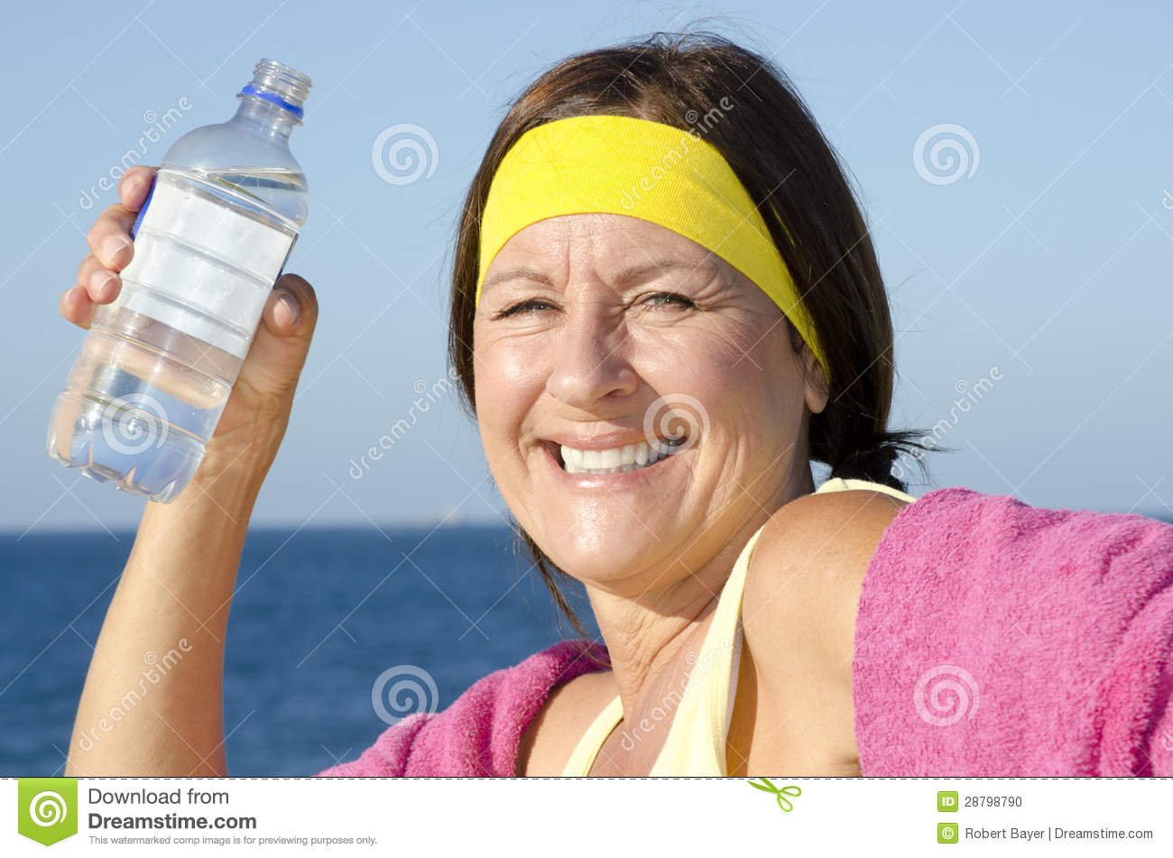 Sporty And Exercising Active Retired Mature Woman Drinking Water