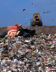 Colorful Photograph Of A Garbage Landfill Showing Acres Of Trash