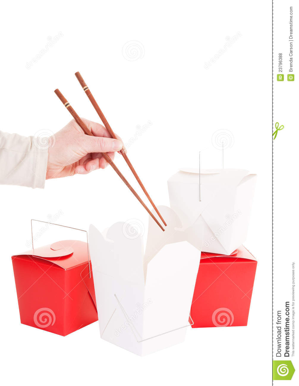 Hand With Chopsticks About To Dig Into Some Chinese Take Out Food