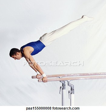 Stock Photo   Young Male Gymnast Performing Routine On Parallel Bars