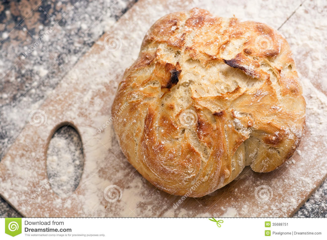 Freshly Baked Artisan Bread On A Marble Background And Cutting Board