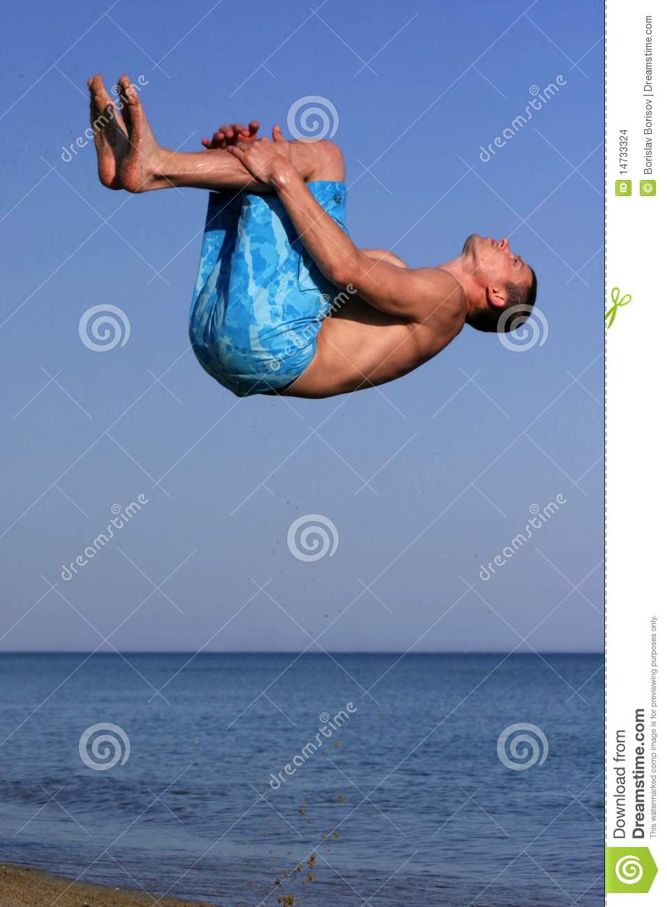 Athletic Man Makes Somersault On The Beach