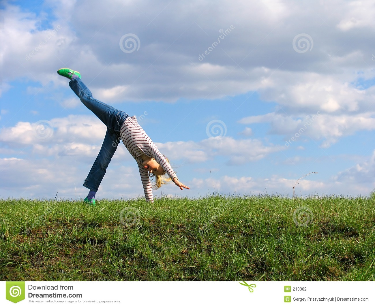 Somersault On Grass On The Sky Clouds Background