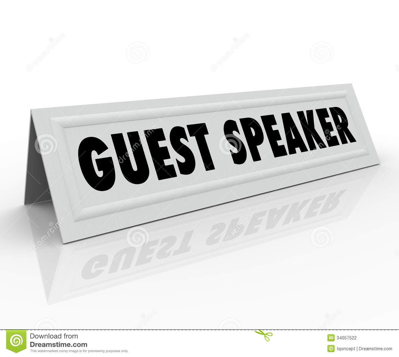 The Words Guest Speaker On A Paper Folded Tent Card To Illustrate The