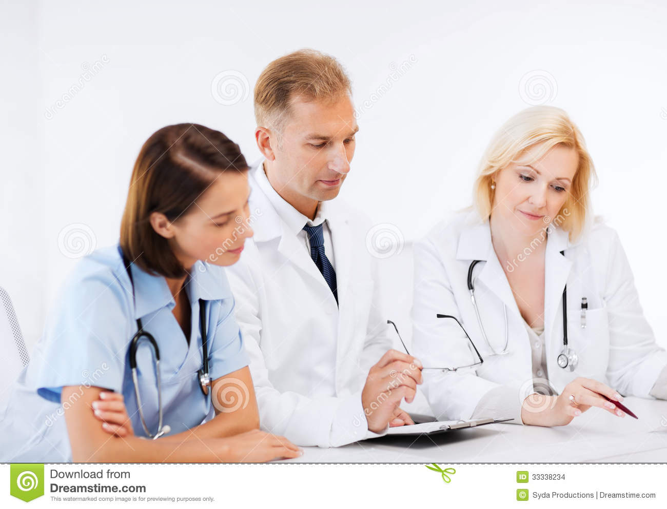 Healthcare And Medical Concept   Team Or Group Of Doctors On Meeting