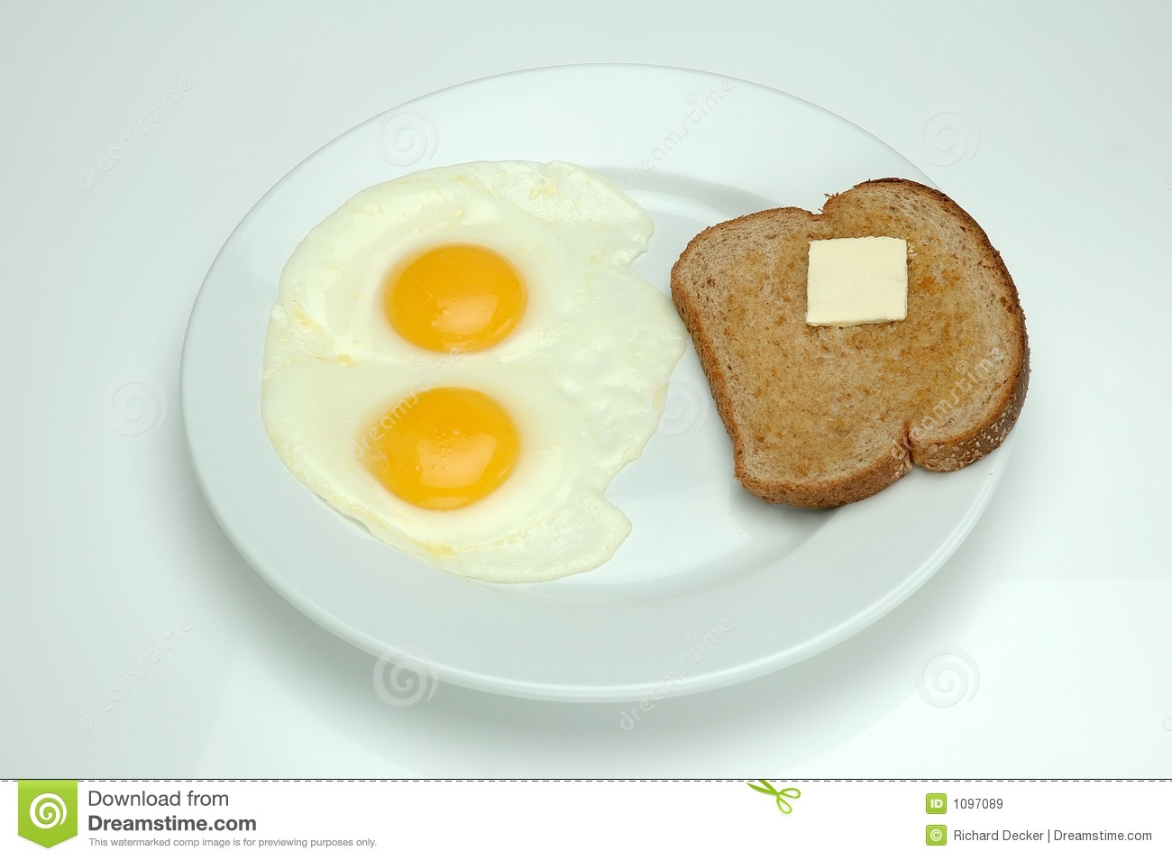 Two Sunny Side Up Eggs And Toast For Breakfast To Start Off The Day