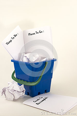 Bucket Filled With Wadded Up Paper And Sheets Listing Things To Do