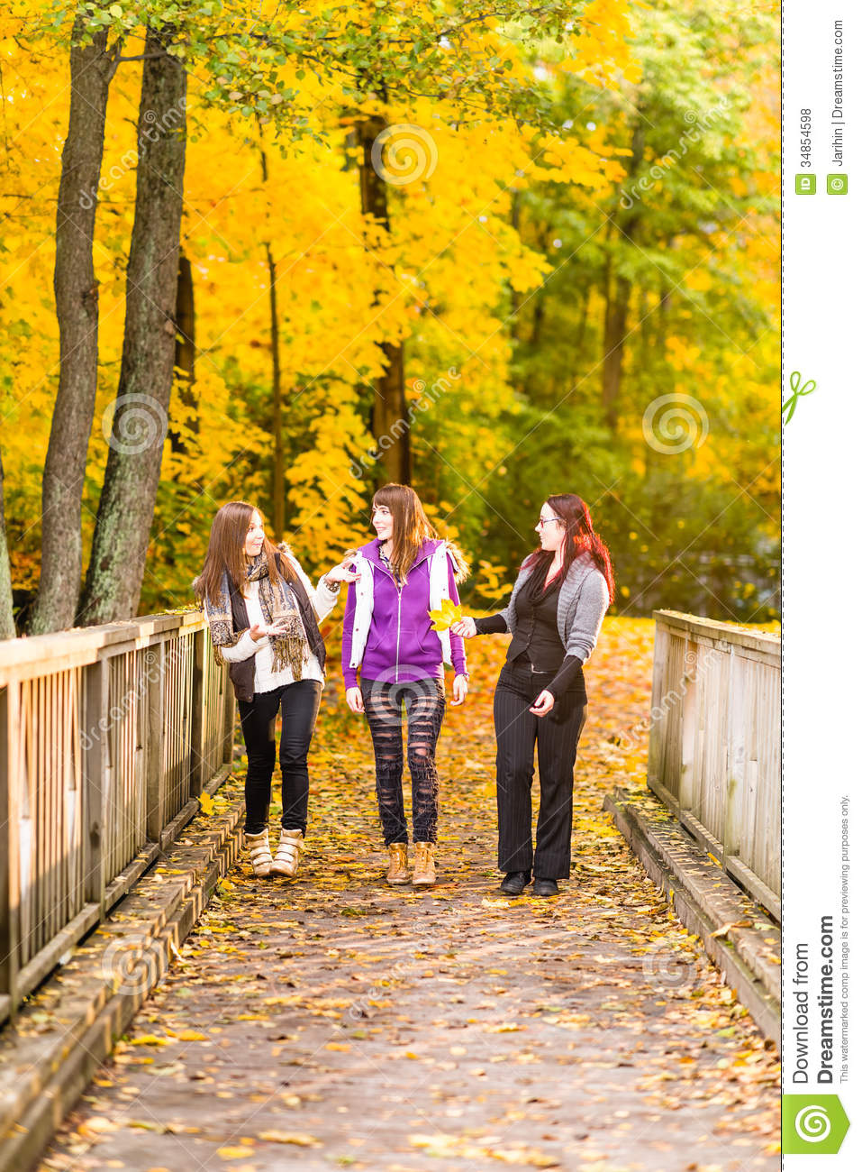 Three Sisters Walking On Bridge And They Have A Fun Together On
