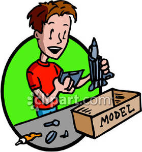 Boy Building A Model Rocket   Royalty Free Clipart Picture