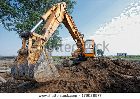 Excavator Digging A Trench On The Site Focus On The Excavator Back