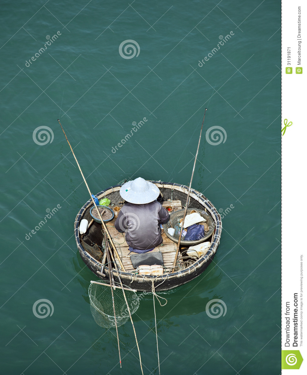 Birds Eye View Of Man In Traditional Round Vietnamese Fishing Boat