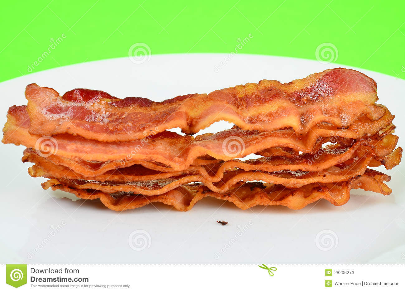 Closeup Of Six Strips Of Bacon Still Sizzling Hot On White Plate With