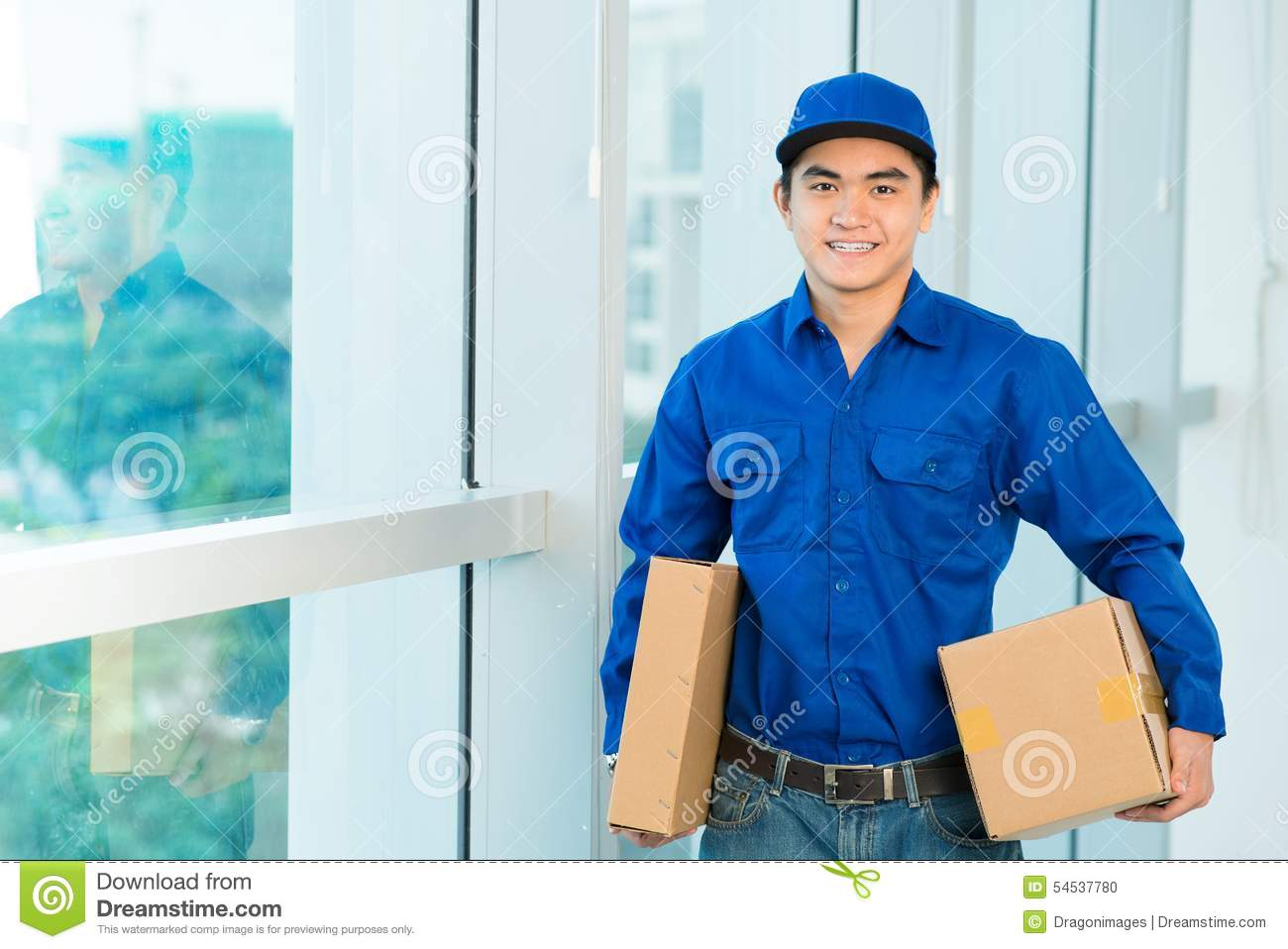 Portrait Of Smiling Vietnamese Delivery Man Holding Parcels