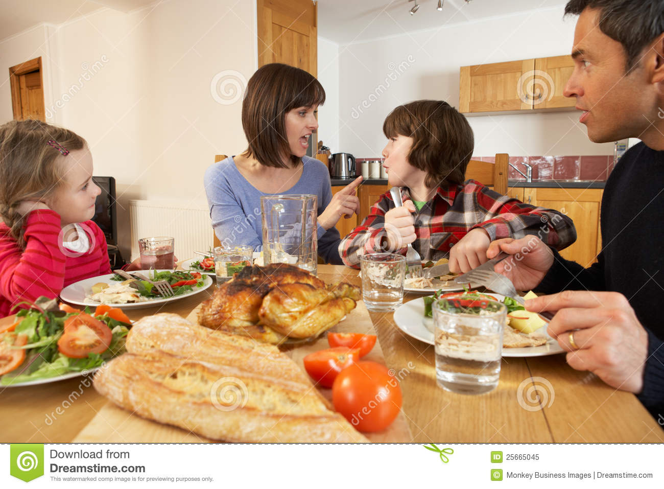 Family Having Argument Whilst Eating Lunch Royalty Free Stock Photo
