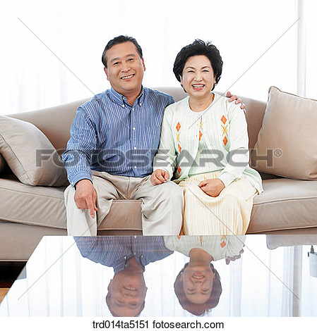 Stock Photography   An Old Couple On A Sofa  Fotosearch   Search Stock