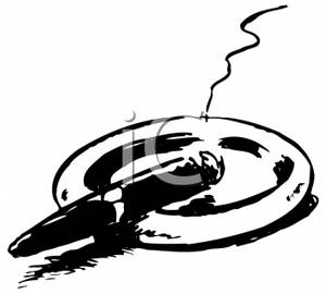 Black And White Cigar Sitting In An Ashtray   Royalty Free Clipart