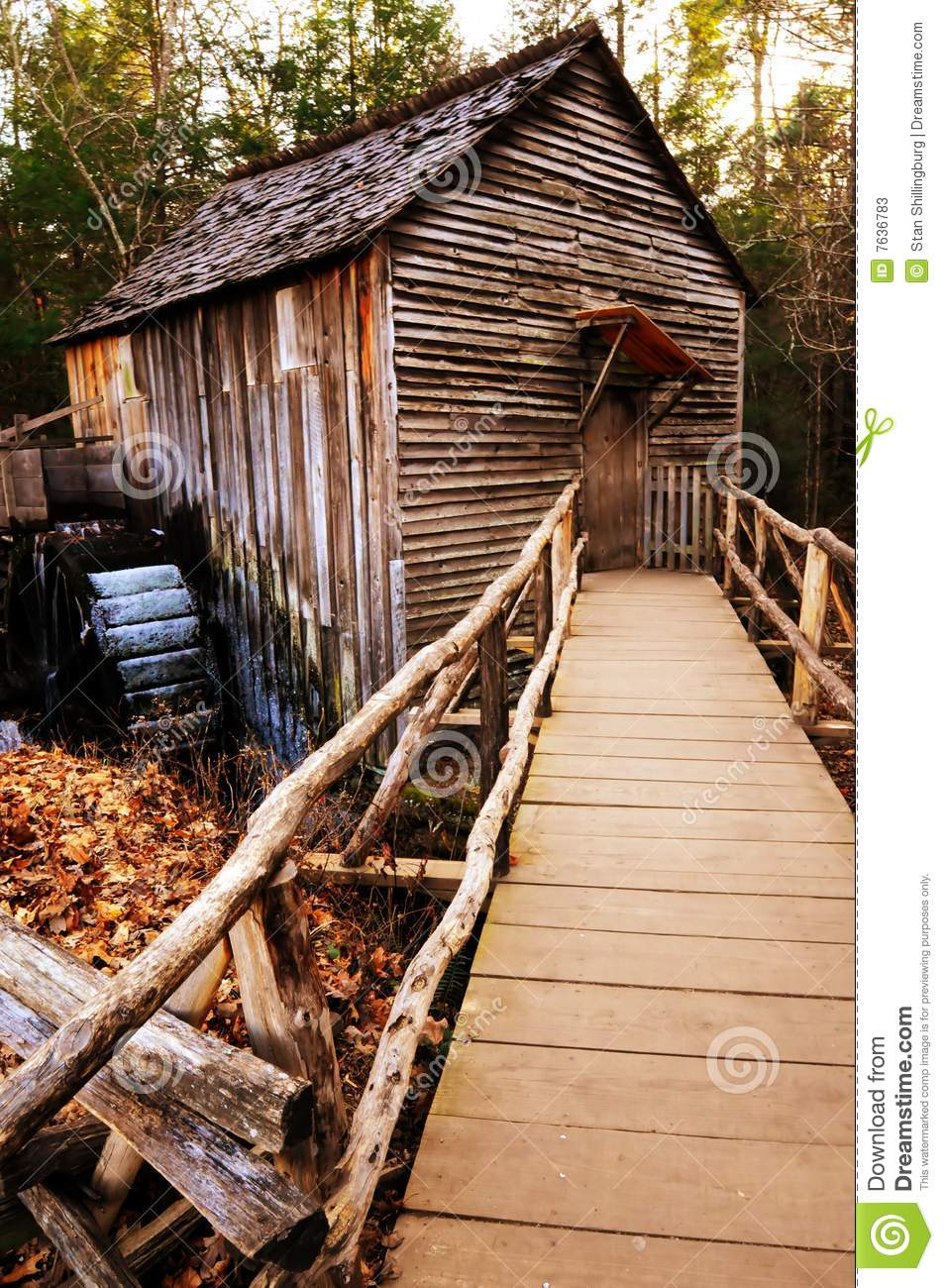Grist Mill With Footbridge And Rails  Also Seen Is The Waterwheel