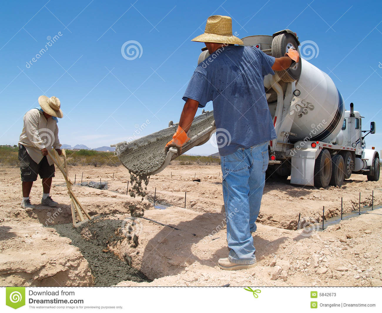 Men Guiding Cement Into Trench   Horizontal Stock Photos   Image