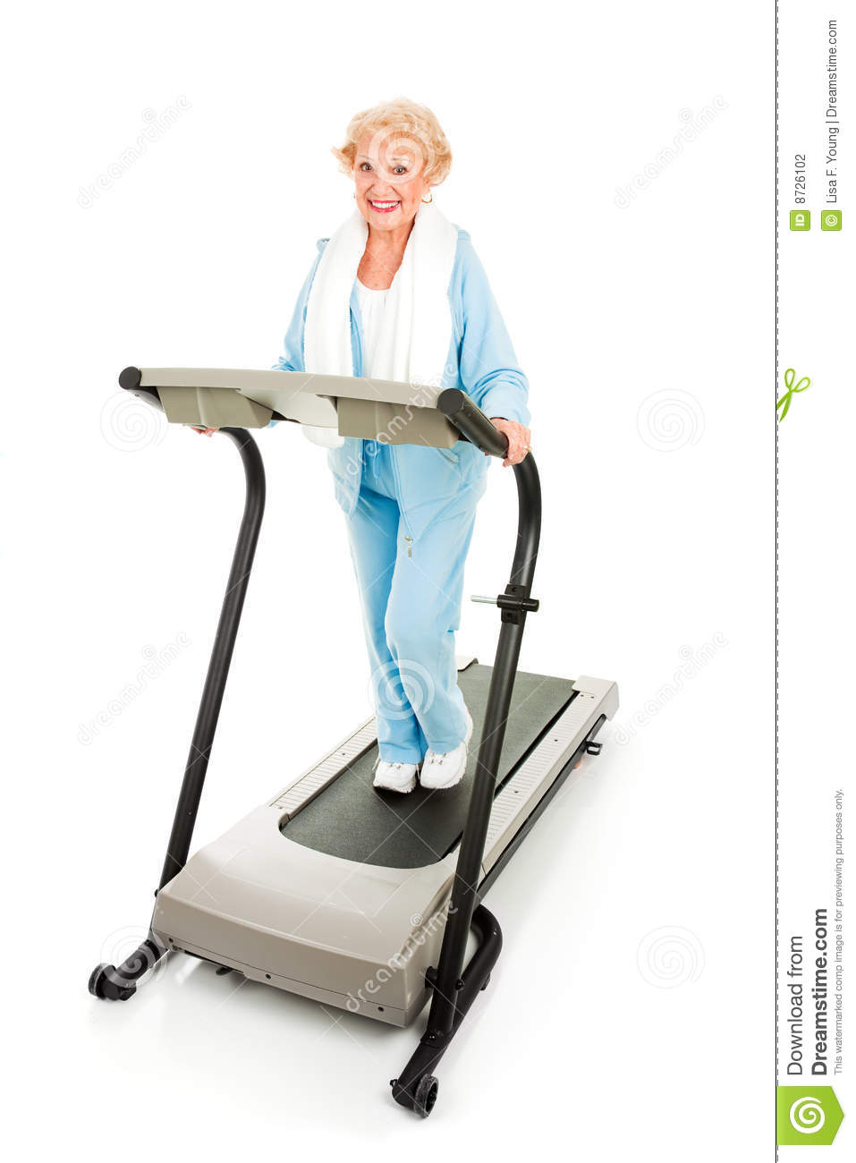 Beautiful Senior Woman Stays Fit By Exercising On A Treadmill