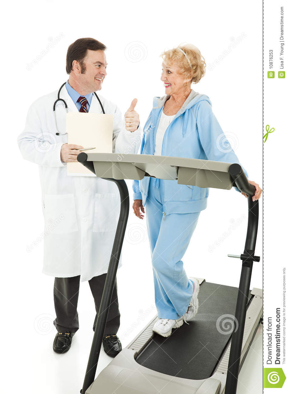 Fit Senior Woman On Treadmill Gets A Thumbs Up From Her Doctor