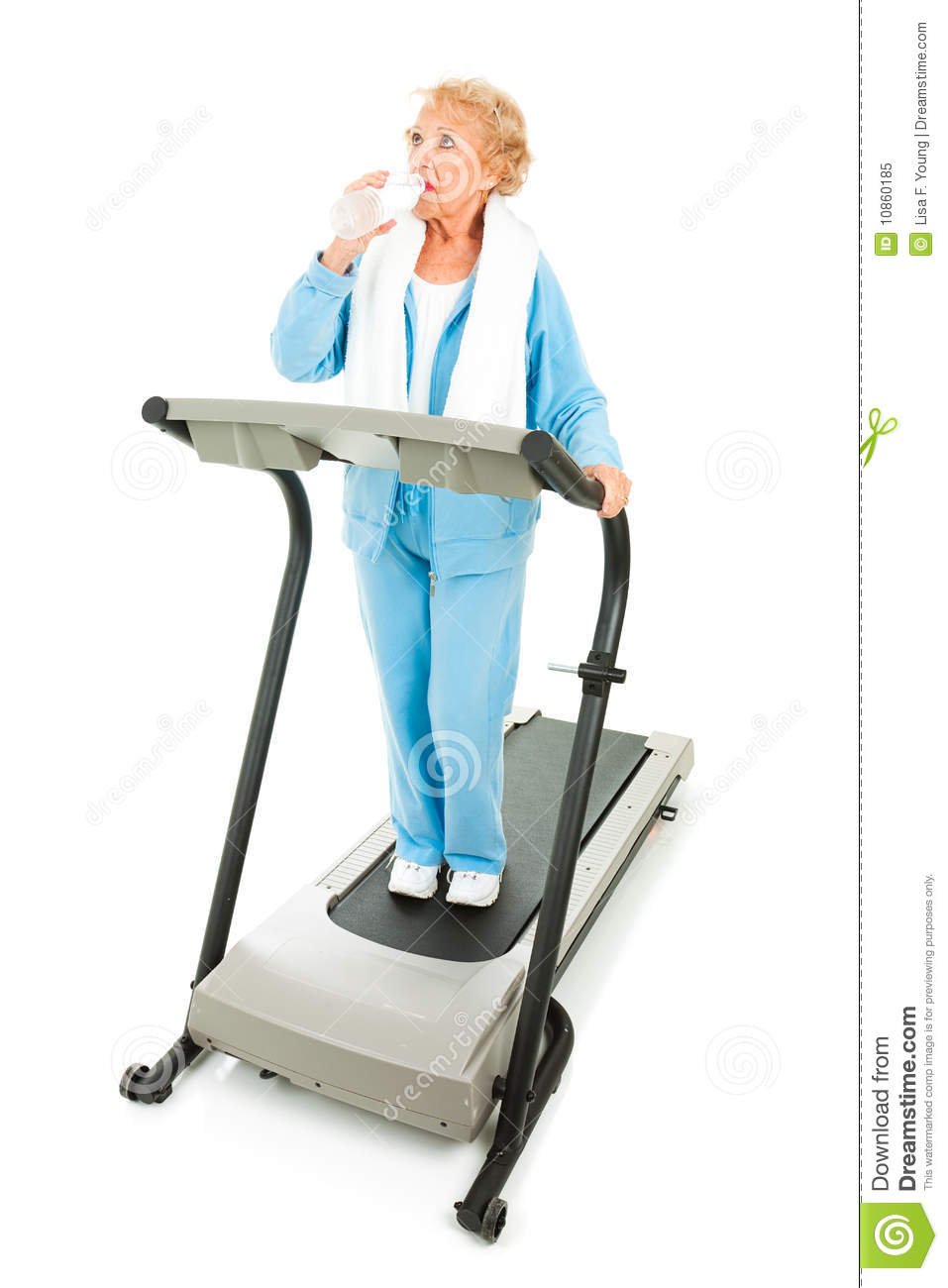 Fit Senior Woman Working Out On A Treadmill Taking A Break To Stay