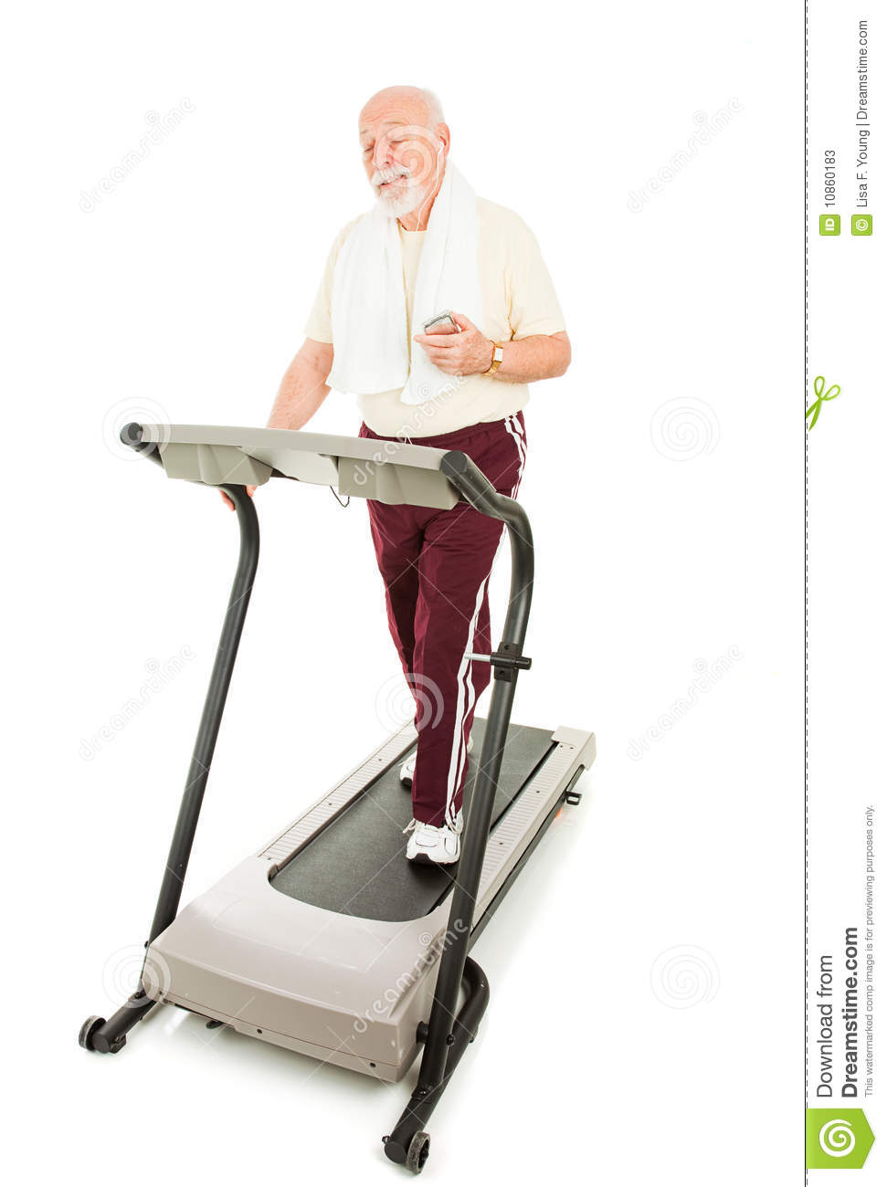 Senior Man Enjoys Music On His Mp3 Player While He Walks On The