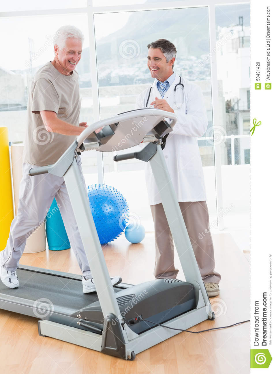 Senior Man On Treadmill With Therapist Stock Photo   Image  50491428