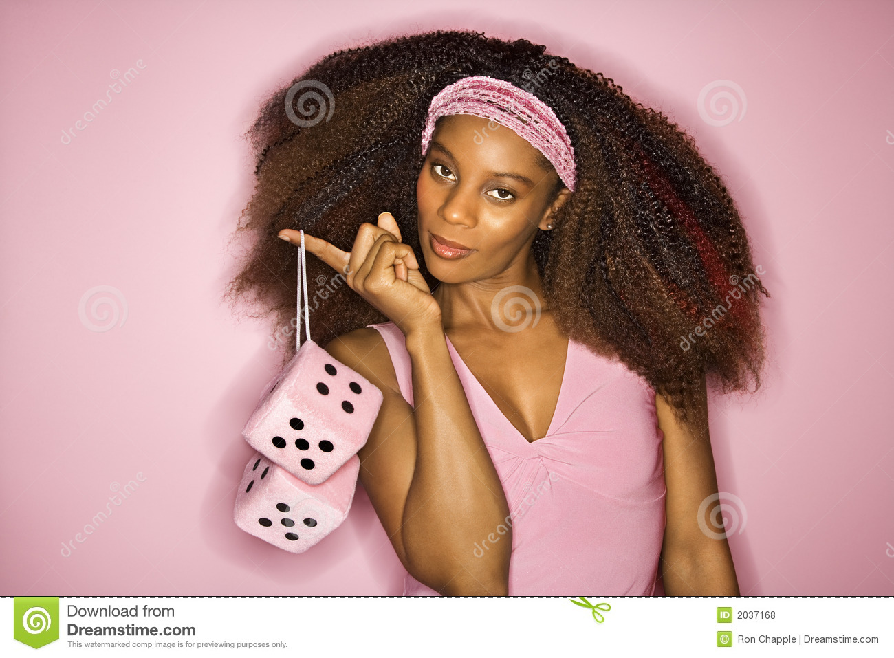 African American Woman Holding Fuzzy Dice  Royalty Free Stock Photos