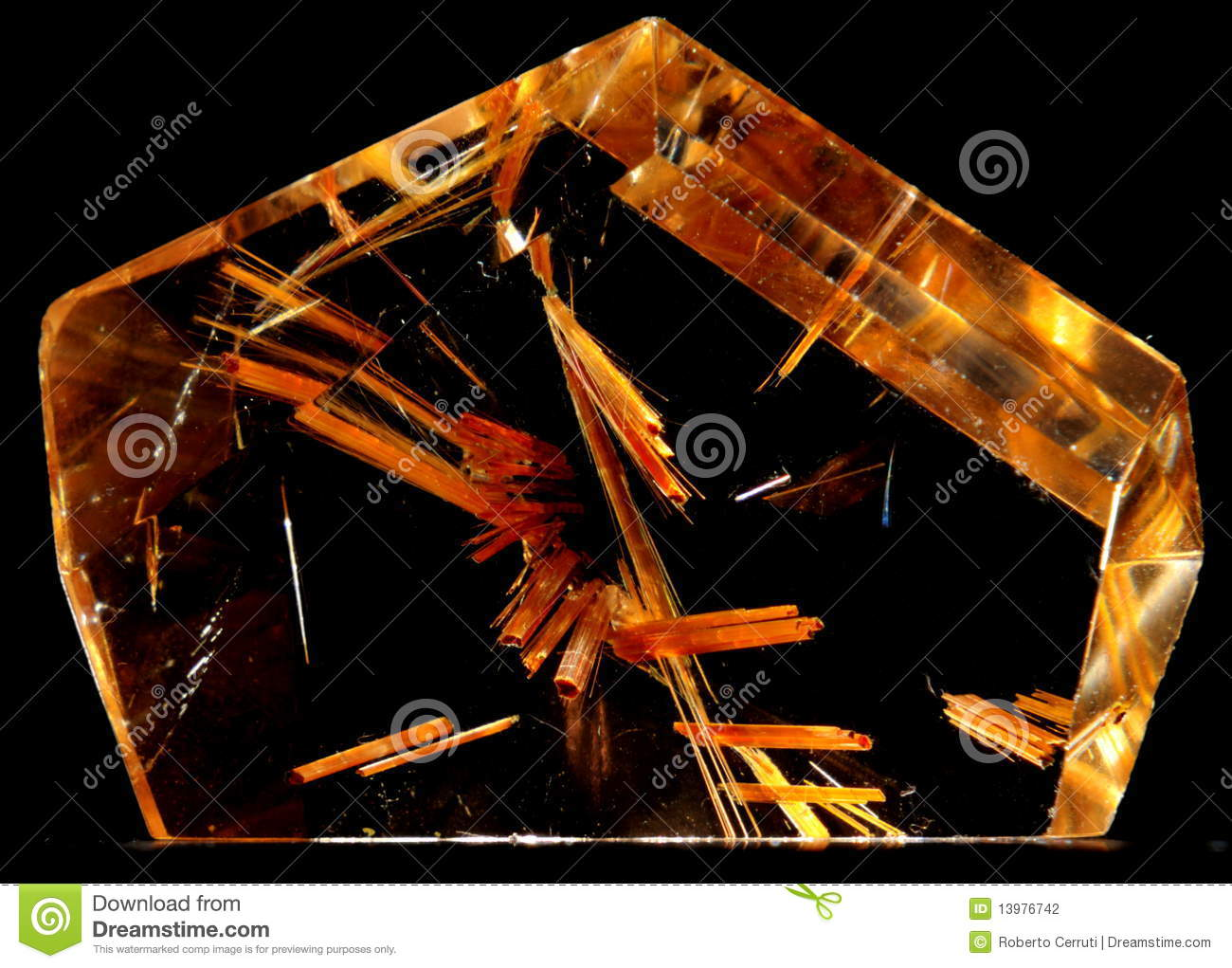Rutile Included In A Cut And Polished Quartz Crystal Isolated On Black