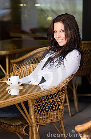 Portrait Of Gorgeous Young Brunette At The Coffee Shop