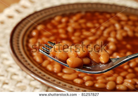 Hot Delicious Baked Beans On Fork With Bowl Of Beans In Soft Focus In