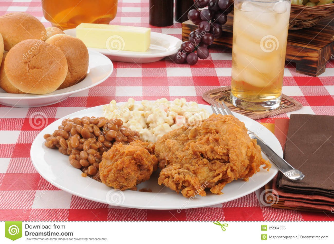 Plate Of Fried Chicken With Boston Baked Beans And Rolls On A Picnic