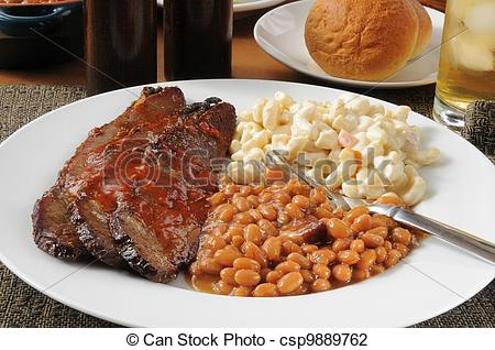 Stock Photo Of Sliced Beef Brisket With Boston Baked Beans   Closeup