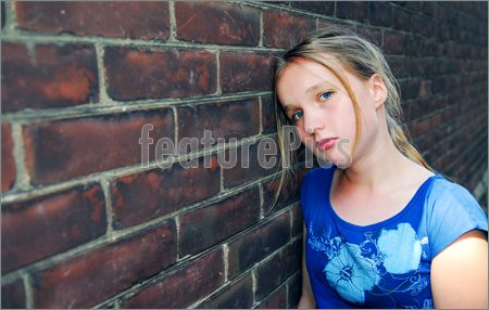 Picture Young Girl Near Brick Wall Looking Upset