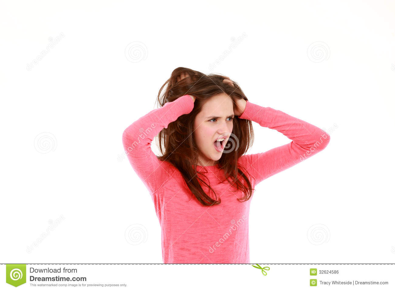 Shocked Teen Girl With Hands In Hair Looking Away From Camera Isolated