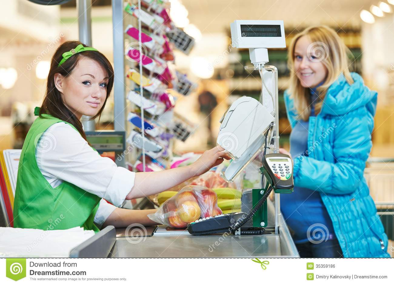 Customer Buying Food At Supermarket And Making Check Out With Cashdesk