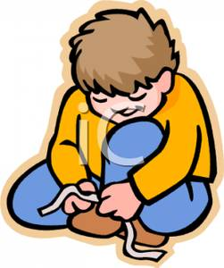 Boy Tying Shoes   Royalty Free Clipart Picture