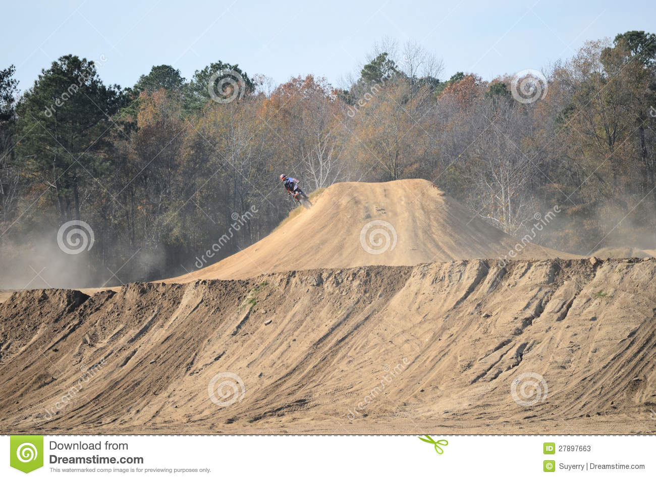 Dirt Bike Riding On The Side Of A Large Dirt Hill At Busco Beach And
